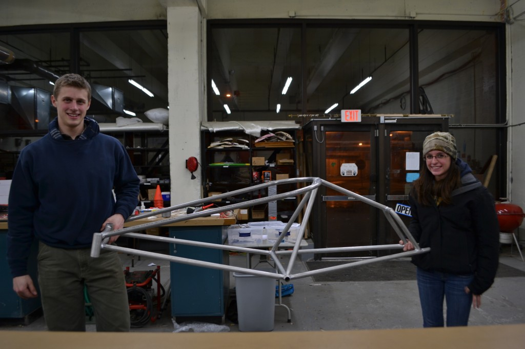 Karl Hundt and Lauren Goulet holding the 2015-2016 chassis